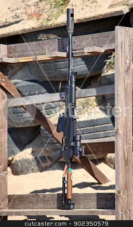 AK-47   stock photo, Kalashnikov rifle AK-47    under the cartridge of 12 gauge by mrivserg