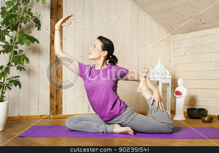 yoga woman  stock photo, An image of a pretty woman doing yoga at home by Markus Gann