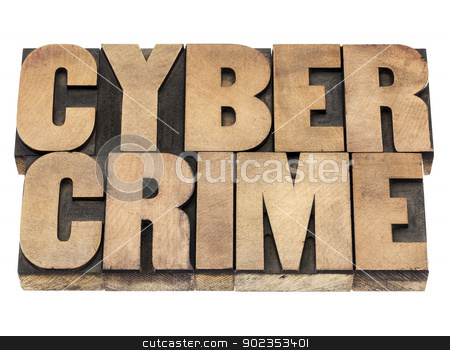 cyber crime in wood type stock photo, cyber crime - isolated text in vintage letterpress wood type printing blocks by Marek Uliasz