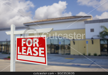 Vacant Retail Building with For Lease Real Estate Sign stock photo, Vacant Retail Building with For Lease Real Estate Sign in Front. by Andy Dean