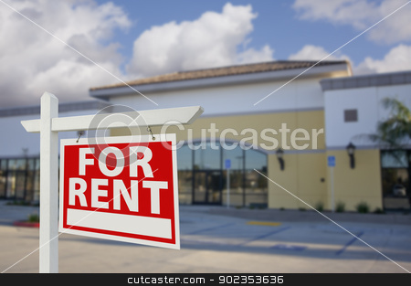 Vacant Retail Building with For Rent Real Estate Sign stock photo, Vacant Retail Building with For Rent Real Estate Sign in Front. by Andy Dean