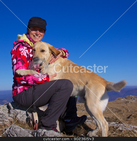 Girl and her dog stock photo, Pretty young girl cuddling with her dog on a sunny autumn day by Harvepino