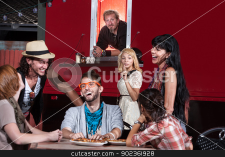 Ordering Pizza at Food Truck stock photo, Woman taking orders for friend at mobile pizza restaurant by Scott Griessel