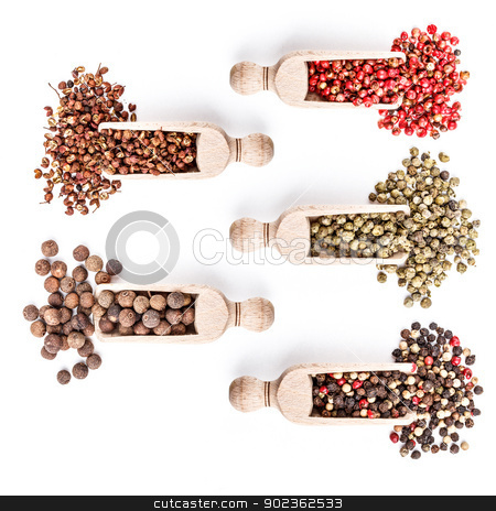 Collection of spices stock photo, Wooden shovels with different spices scattered from them by Grafvision