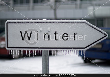 Winter sign stock photo, Sign covered by snow and icicles shows the way to the Winter (German word for winter) by Harry Huber