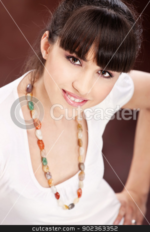 woman white dressed with necklaces stock photo, Pretty smiled woman white dressed with necklaces by iMarin