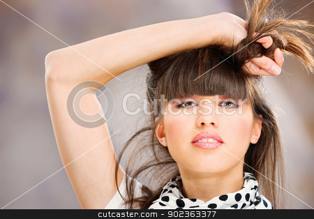 Pretty woman with white scarf stock photo, Pretty woman holding her hair with one hand by iMarin