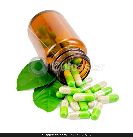 Capsules green in an open jar with leaf stock photo, Green capsules in an open brown jar and on the table, two green leaf isolated on white background by rezkrr