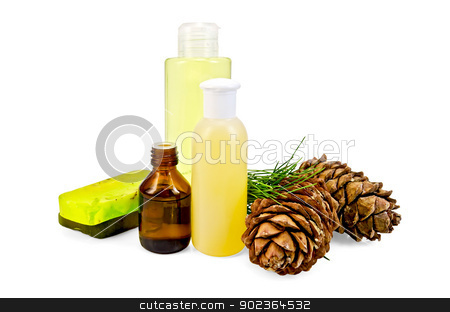 Oil with lotion and cedar cones stock photo, Cedar oil in a bottle, two cedar cones, two green homemade soap, body lotion, shower gel isolated on white background by rezkrr