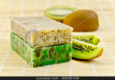 Soap homemade with kiwi stock photo, Two green homemade soaps, kiwi slices on a bamboo napkin by rezkrr