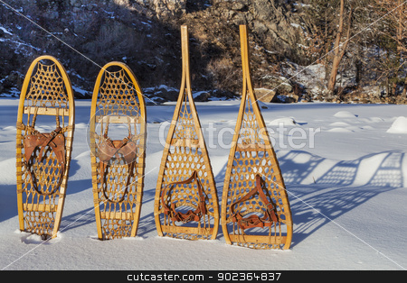 vintage snowshoes stock photo, vintage Bear Paw and Huron snowshoes cast shadow in snow, Poudre River Canyon near Fort Collins, Colorado by Marek Uliasz