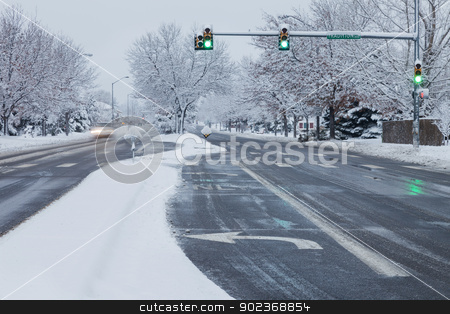 city street in winter weather stock photo, winter snowstorm on streets of Fort Collins, Colorado by Marek Uliasz