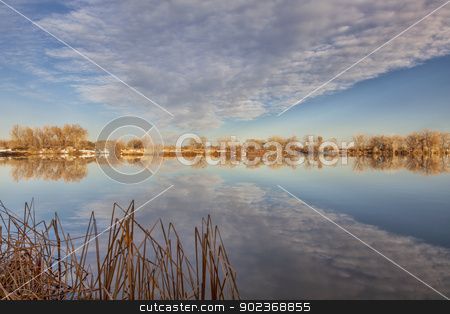 calm lake in Colorado stock photo, calm lake with cloud reflection - Arapaho Bend Natural Area in Fort Collins, Colorado by Marek Uliasz