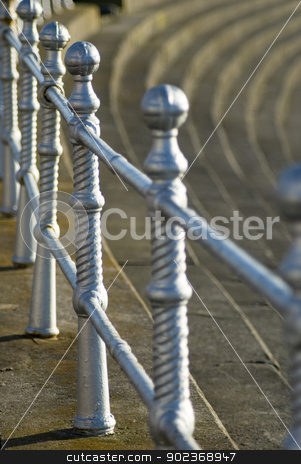 Railings on Blackpool promenade stock photo, Ornate silver painted metal railings on Blackpool promenade above the steps leading down to the beach by Stephen Gibson