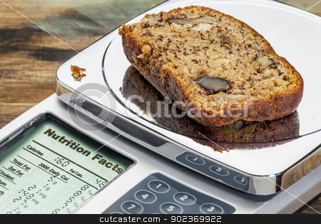 banana bread on diet scale stock photo, slice of banana bread with walnuts on diet scale displaying nutrition facts - a diet concept by Marek Uliasz