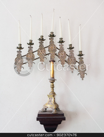 Antique jewish menorah and candles stock photo, Antique ornate menorah in brass with old tallow candles by Steven Heap
