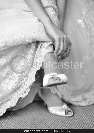 Bride  stock photo, The bride is putting on her shoes for the wedding day. by szefei