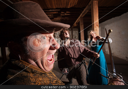 Angry Swordsman Attacking stock photo, Angry swordsman dueling with European male indoors by Scott Griessel