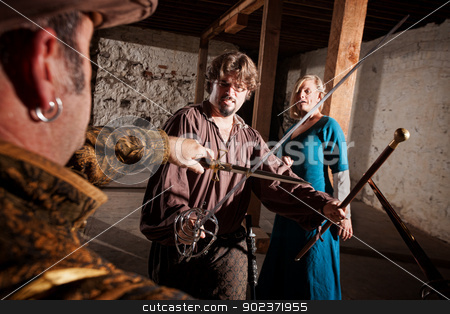 Medieval Hero Swordfighting stock photo, European Renaissance hero defending woman against swordsman by Scott Griessel
