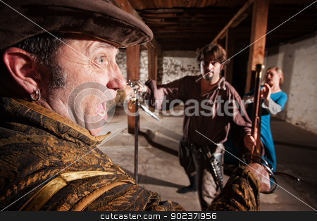 Swordsman Attacking Man and Woman stock photo, Berserk swordsman attacking man and woman indoors by Scott Griessel