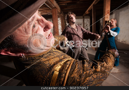 Renaissance Swashbucklers Dueling stock photo, Brave medieval man protecting his lady from attack by Scott Griessel