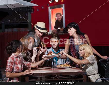Hipsters at Mobile Pizza Shop stock photo, Group of Hipsters eating pizza at a mobile cafe by Scott Griessel