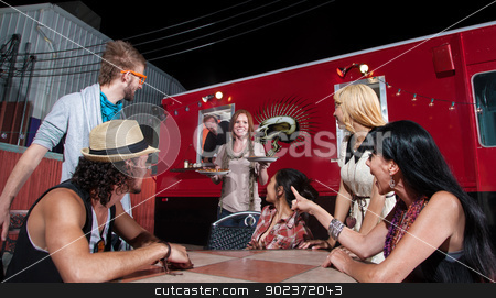 Pizza Orders at Food Truck stock photo, Cheerful waitress bringing orders to people at pizza truck by Scott Griessel