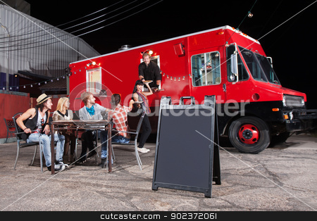 Happy Customers at Food Truck stock photo, Happy diners at food truck with blank sign by Scott Griessel