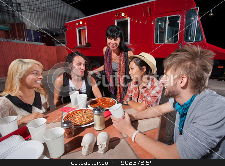 Hipsters with Plates of Pizza stock photo, Five hipsters at mobile pizza restaurant with plates of food by Scott Griessel