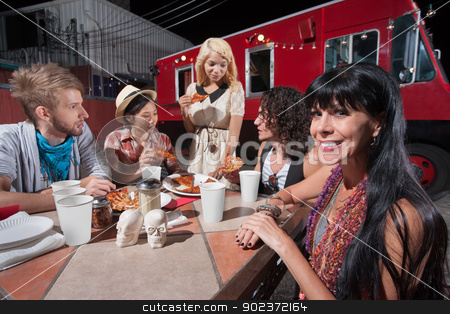 Woman with Friends at Mobile Cafe Table stock photo, Cute mature hipster with young friends eating pizza by Scott Griessel