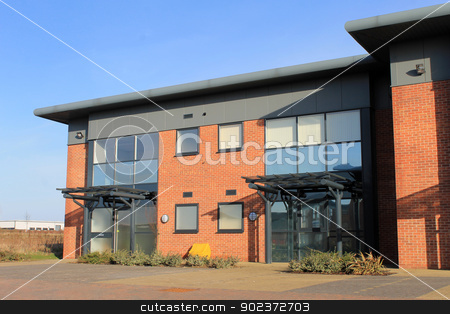 Empty modern office building stock photo, Exterior of empty modern office building on business park, Scarborough, England. by Martin Crowdy