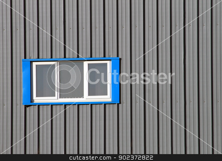 Modern industrial building stock photo, Blue window on modern industrial building with gray corrugated iron. by Martin Crowdy