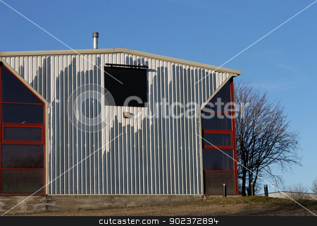 Old industrial building stock photo, Exterior of old industrial building with blank sign. by Martin Crowdy