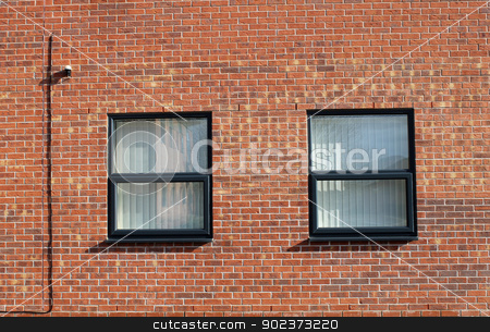 Windows in brick wall stock photo, Windows in brick wall of modern office building. by Martin Crowdy