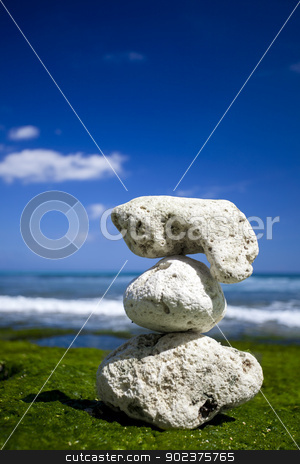 White Stones in a beach stock photo, Beautiful tropical beach with white stones on the rocks by ikostudio