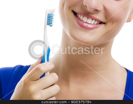 Beautiful woman with a toothbrush stock photo, Beautiful woman with a great smile holding toothbrush, isolated over a white background by ikostudio