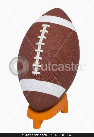 Football on tee stock photo, Football on tee, isolated on white, includes clipping path by Bryan Mullennix