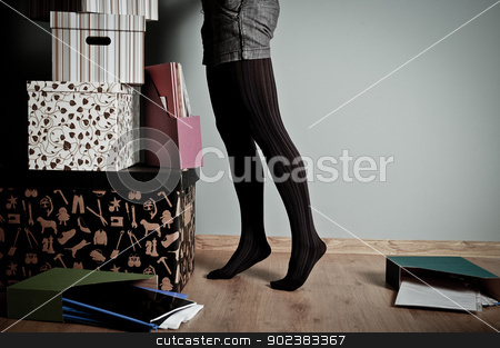 Things to do stock photo, Young woman searching in the pile of stuff to do by kamsta