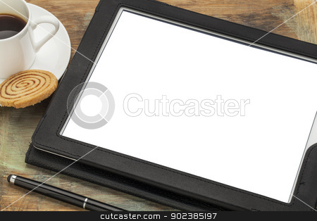 digital tablet with blank screen stock photo, digital tablet computer in black leather case with white blank screen isolated with clipping path, stylus pen, coffee cup and cookie by Marek Uliasz