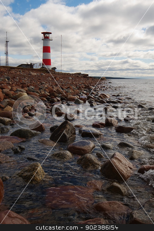 Beacon on coast of northern sea stock photo, Beacon on coast of cold northern sea by Alexey Romanov