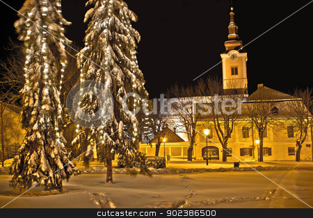 Idylic winter cityscape evening in snow stock photo, Christmas time idylic winter cityscape evening in snow, Town of Krizevci, Croatia by xbrchx