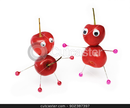 Amusing sweet cherry stock photo, Two amusing little men collected from a sweet cherry by Alexey Romanov