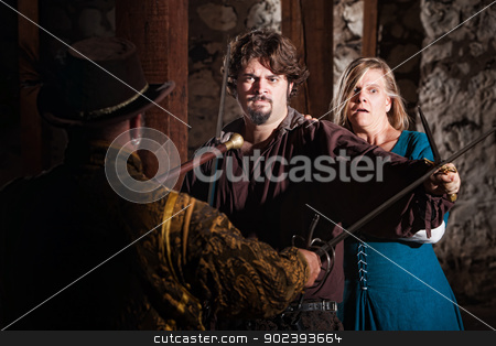 Hero Blocks Attack stock photo, Tough hero defending woman against mace and sword by Scott Griessel