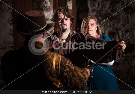 Confident Hero and Scared Lady stock photo, Confident medieval man with scared woman by Scott Griessel