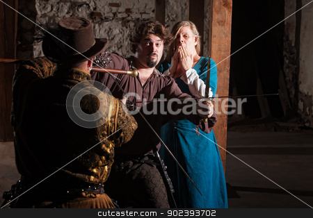 Swordsman Defending Lady stock photo, Handsome European swordsman defending damsel in distress by Scott Griessel