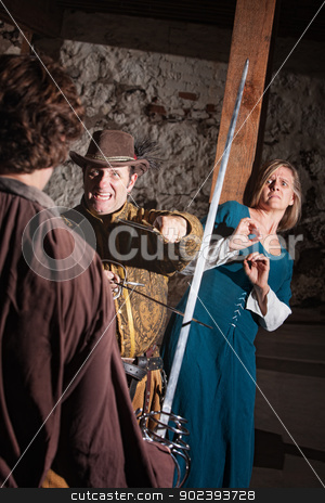 Scared Woman and Sword Fighter stock photo, Scared medieval lady behind aggressive sword fighter in battle by Scott Griessel