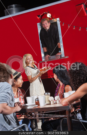 People Eating at a Canteen stock photo, Group of happy people eating near a canteen by Scott Griessel