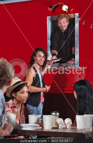 Getting Pizza Take-Out Order stock photo, Young man with pizza take out from food truck by Scott Griessel