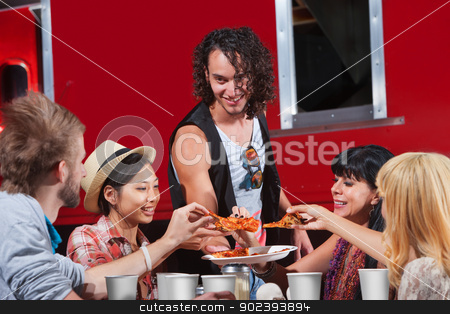 People Sharing Pizza stock photo, Happy group of people sharing slices of pizza by Scott Griessel