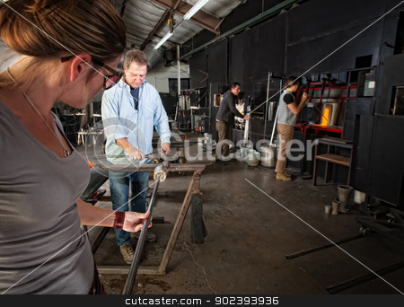 Workers Making Glass Objects stock photo, Four men and women busy in a glass making workshop by Scott Griessel